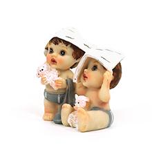 La figurine bébés jumeaux pour baptême