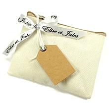 Le porte monnaie en tissu contenant à dragées pour mariage, communion ou baptême